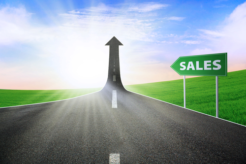 A Road Turning Into An Arrow Rising Upward With A Road Sign Of Sales, Symbolizing The Way To Improve Sales