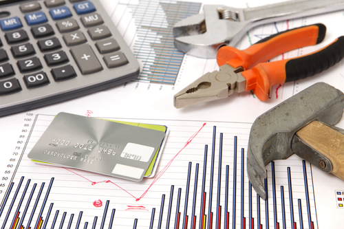 A Photo Of Housebuilding Graphics And Hammer And Credit Cards