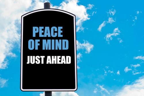 PEACE OF MIND JUST AHEAD  Motivational Quote Written On Road Sign Isolated Over Clear Blue Sky Background With Available Copy Space. Concept  Image