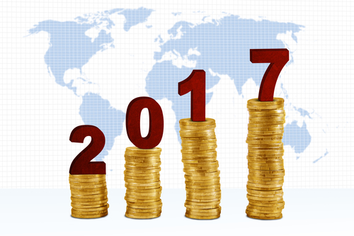 Image Of Four Piles Coins With Numbers 2017 And World Map On The Background