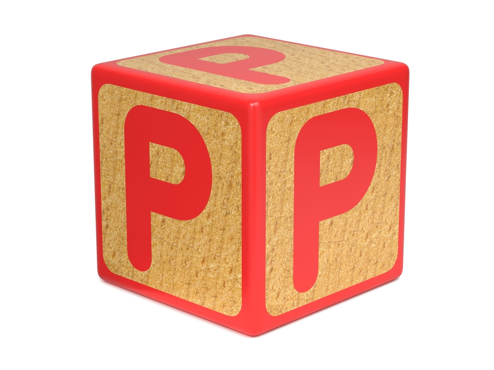 Letter P On Red Wooden Childrens Alphabet Block  Isolated On White. Educational Concept.