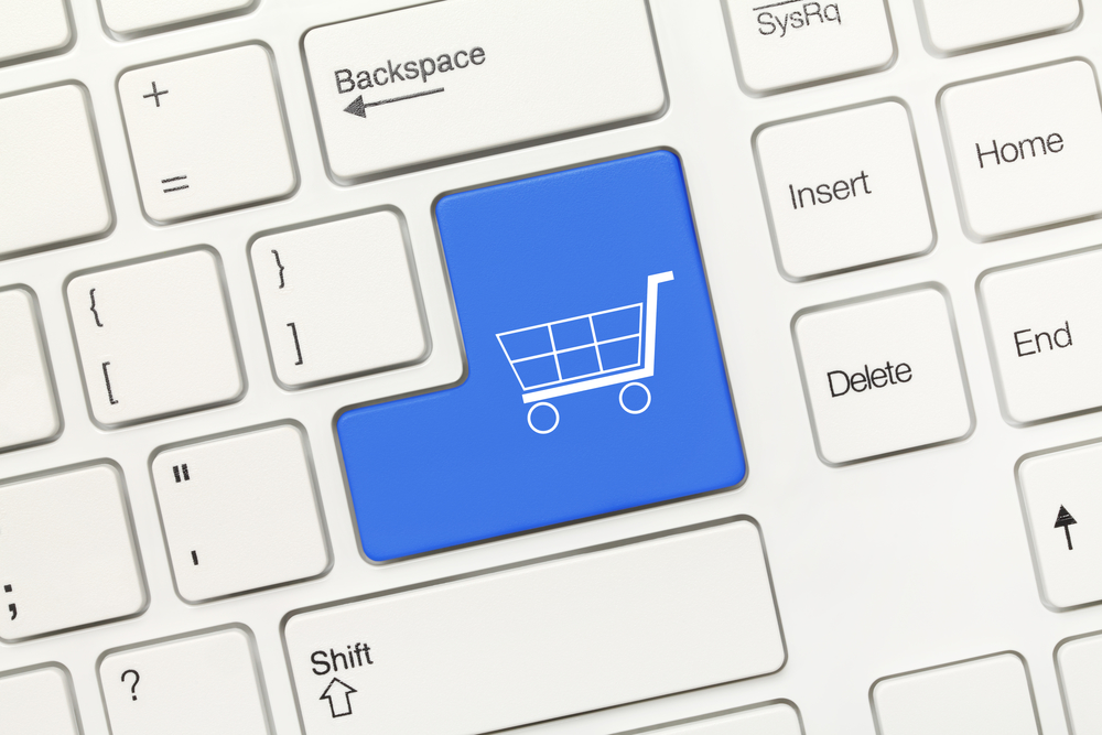 Close-up View On White Conceptual Keyboard - Blue Key With Shopping Cart Symbol
