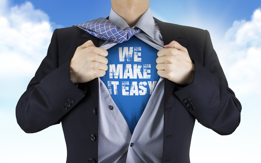 Businessman Showing We Make It Easy Words Underneath His Shirt Over Blue Sky
