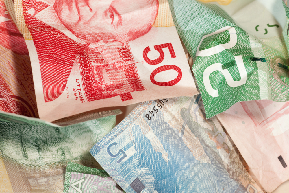 Crumpled Canadian Dollar Bills Close-up, Currency Crisis Concept
