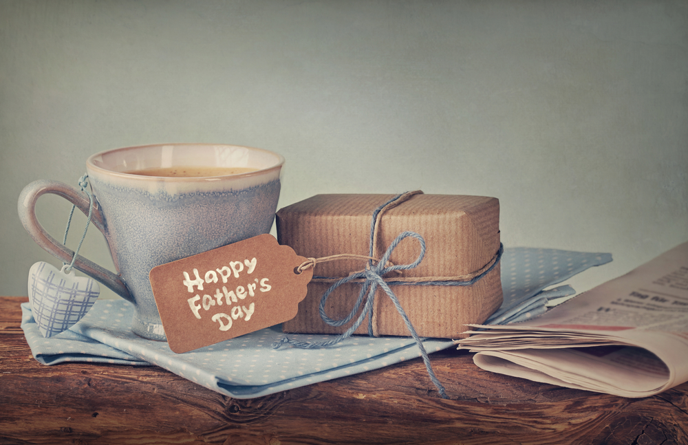 Gift Box With A Tag And A Cup Of Coffee